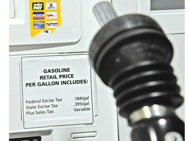 A gas tax sticker is posted on a pump at the Shell gas station on the corner of Valencia Boulevard and McBean Parkway on Friday.