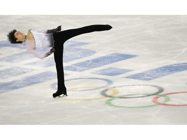 Yuzuru Hanyu of Japan competes in the men's free skate figure skating final during the Winter Olympics on Friday in Sochi, Russia.