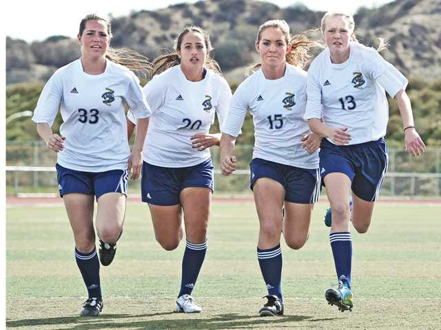 West Ranch defensive players (from left) Gianna Crimi, Dorna Ektefaie, Kimy Leggat, Jessy Holen and Marissa Magsarili (not pictured) have been keys to the Wildcats girls soccer team in 2014. The team is hoping to earn a spot in the CIF-Southern Section postseason.