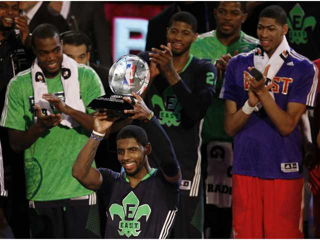 East Team's Kyrie Irving, of the Cleveland Cavaliers, holds the All Star MVP trophy after the NBA All Star game on Sunday in New Orleans.