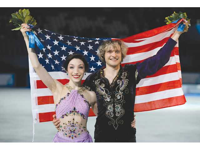 Meryl Davis and Charlie White of the United States pose for photographers after placing first in the ice dance free dance finals on Monday in Sochi, Russia.