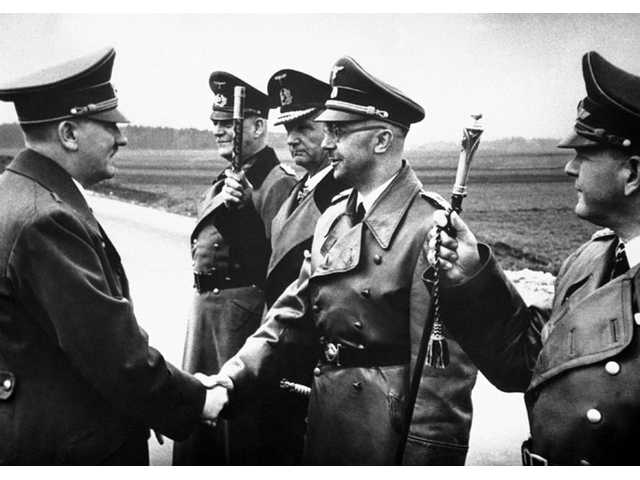The May 18, 1944 file photo shows then German Chancellor Adolf Hitler, left, shaking hands with German Interior Minister and head of the SS, Heinrich Himmler, somewhere in Germany.