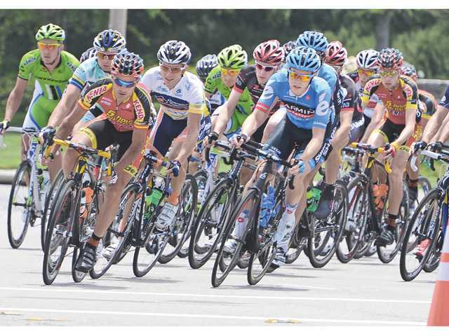 Competitors in the 2013 Amgen Tour of California turn the corner from McBean Parkway onto Newhall Ranch Road in Valencia at the start of Stage 4 of the bicycle race on May 15. Photo by Dan Watson.