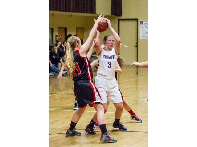 Trinity's Emily Buchanan (3) tries to keep the ball from Arrowhead Christian's Hayley Park (11) on Thursday. Photo courtesy of Wally Caddow.