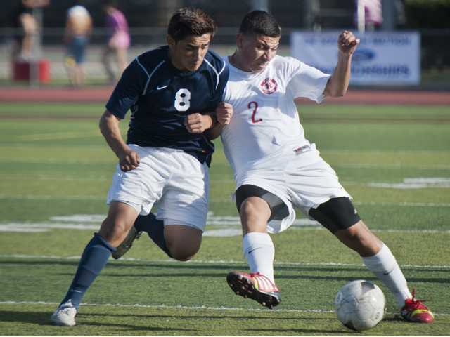 Hart's Jose Pena, right, fights for the ball against Colony's Axl Mendoza during Thursday's CIF-Southern Section Division IV first-round playoff game at Hart High School.