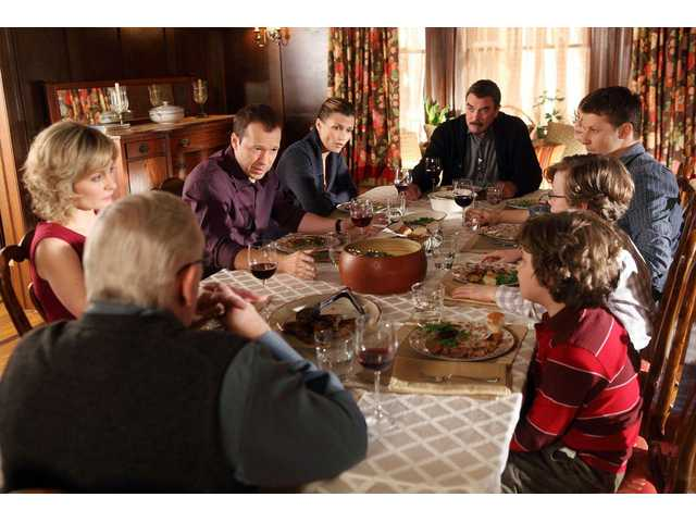 "Tom Selleck, at the head of the table, and the cast of ""Blue Bloods"" gather around for Sunday dinner, over which the family always says grace."