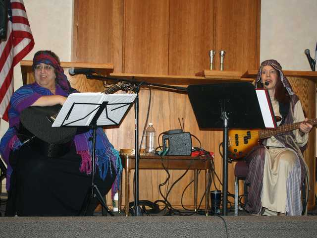 Ter Lieberstein, left, dressed as Miriam, and Wendy Hersh dressed as Devorah of the desert lead the Temple Beth Ami's One Day Women's Retreat in music and song. Courtesy photo