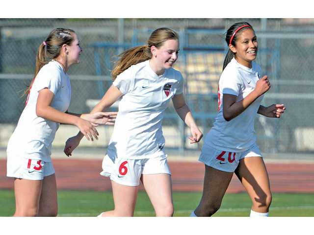 Hart's Sarah Lindborg (6) celebrates with teammates Danielle Spickard (13) and Laura Flores after her goal on Friday at Hart High School.