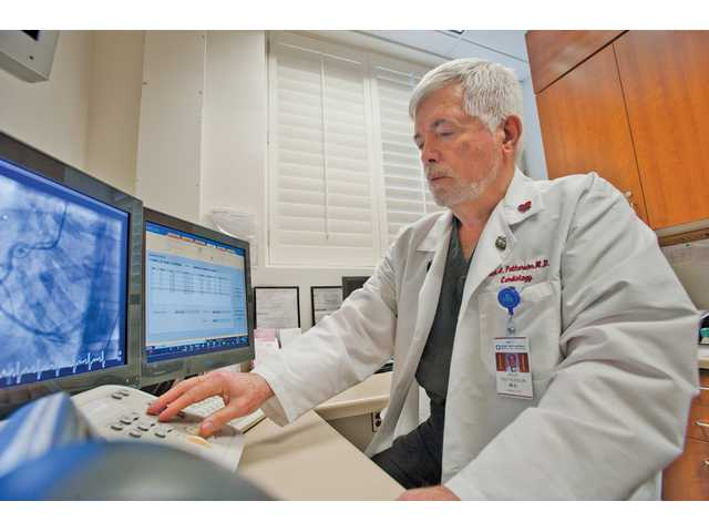 Dr. Jack Patterson looks at an x-ray of a right coronary artery in the STEMI Receiving Center at Henry Mayo Newhall Memorial Hospital.