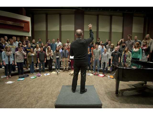 Master's College Chorale conductor, Dr. Paul Plew, leads his chorus during a rehearsal.