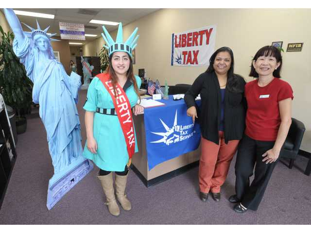 From left, Liberty Tax staff members - Marivy Molina, Marketing Executive, Ritu Khadiya, Owner, and Suzie Nguyen Office Supervisor.