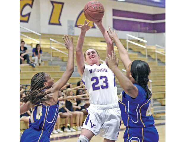Valencia's Kayla Konrad (23) shoots over JW North defenders on Saturday at Valencia High.