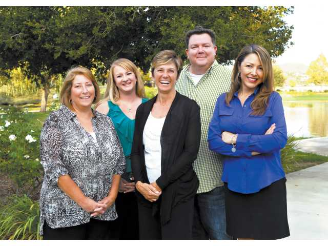 Terri K. Crain, center, and the SCV Chamber of Commerce team.