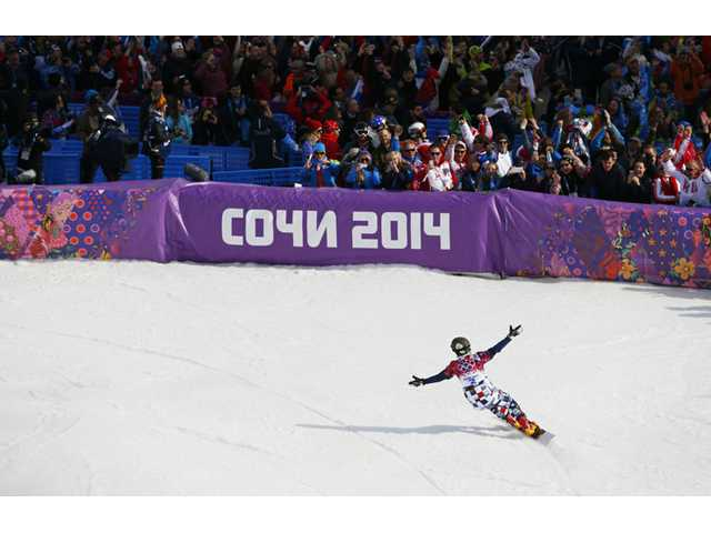 Russia's Vic Wild celebrates his gold medal in the men's snowboard parallel slalom final at the Rosa Khutor Extreme Park at the 2014 Winter Olympics on Saturday in Krasnaya Polyana, Russia.