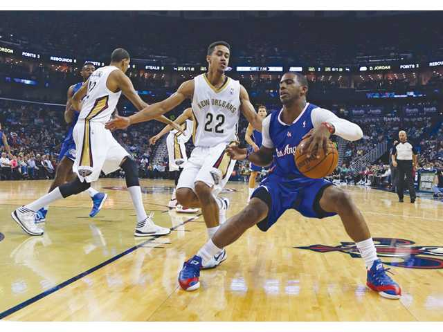 Los Angeles Clippers guard Chris Paul, right, tries to get around New Orleans Pelicans guard Brian Roberts (22) in the first half on Monday in New Orleans.