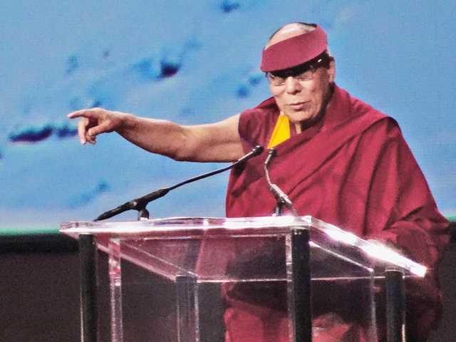 The 14th Dalai Lama, Tenzin Gyatzo, gives a talk on the effects of compassion to a crowd of 8,000 people at the Forum in Inglewood on Tuesday. Signal photo by Charlie Kaijo.