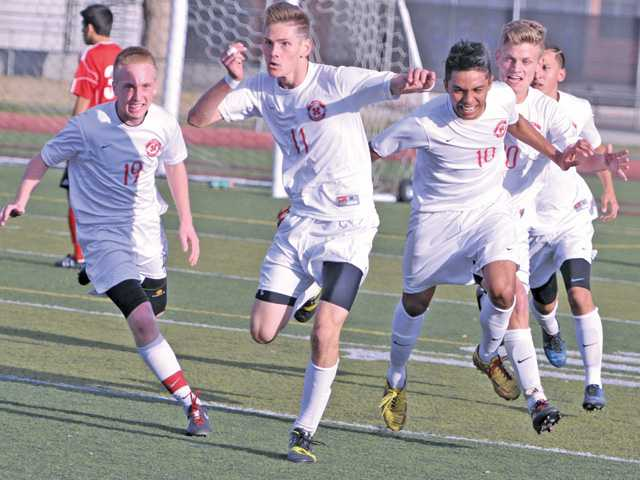Hart's Anthony Salvadori (11) celebrates his goal winning with teammates in the second half against Lawndale at Hart High on Tuesday.