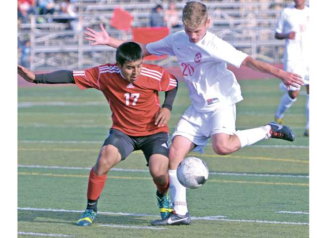 Hart's Andrew Nielsen (20) takes the ball down to score against Lawndale at Hart High on Tuesday.