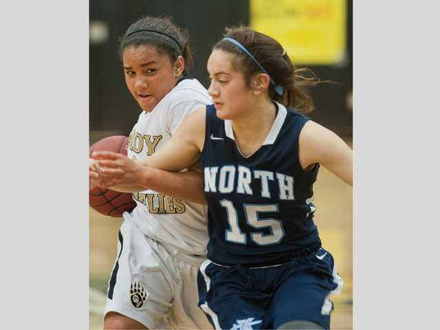 Golden Valley's Destiny Monroe, left, protects the ball against North Torrance on Wednesday at Golden Valley High.