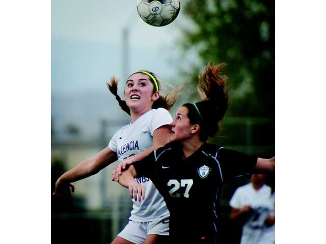 Valencia's Makenna Young, left, heads the ball against Santiago during Wednesday's game at Valencia High.