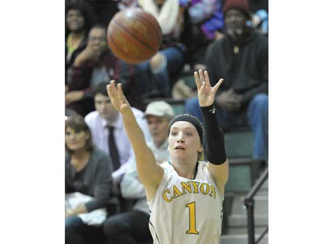 Canyon's Kali Vittallo shoots against Pete Knight at Canyon High in a CIF-Southern Section Division IA playoff game on Wednesday. Canyon won 63-37.