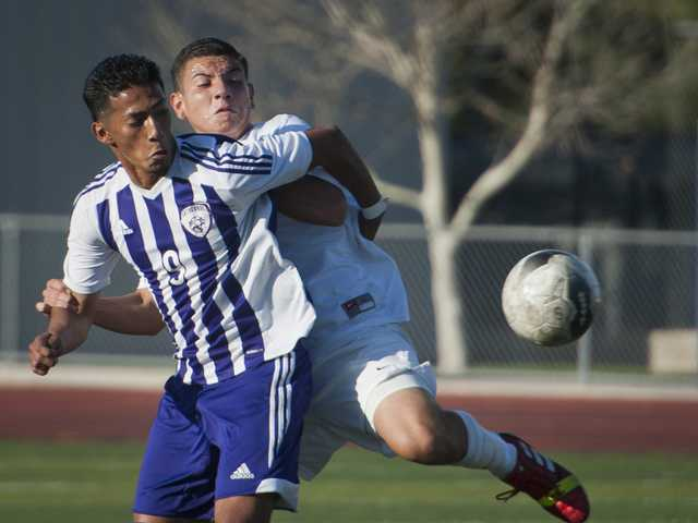 Hart's Jose Pena, back, tries to fight off Cathedral's Miguel Lorenzo on Thursday at Hart High School in the quarterfinals of the CIF-Southern Section Division IV boys soccer playoffs. Hart lost 1-0 to the No. 1 seed.