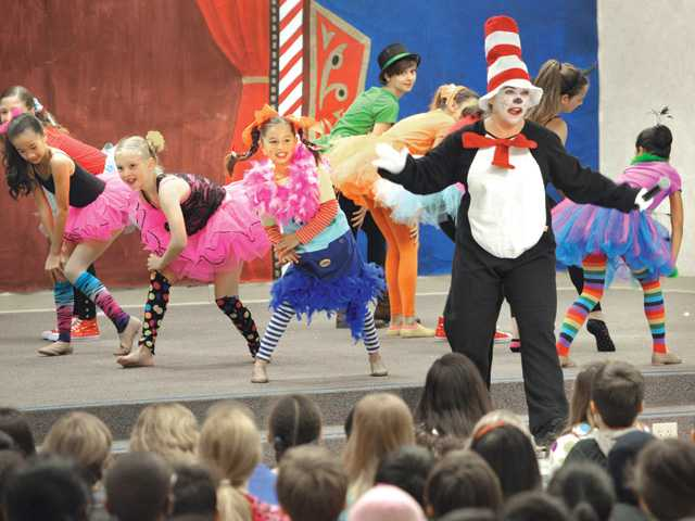 Bridgeport Elementary School Principal Susan Bender, dressed as the Cat in the Hat, dances and sings with students during Friday's Read Across America celebration. Signal photo by Dan Watson