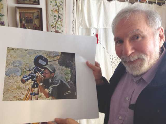 Paul Berkowitz, of Valencia, holds up a photograph of himself taken while he was a photographer in the Vietnam War from 1969-70.