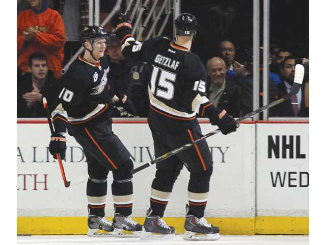 Anaheim Ducks right wing Corey Perry, left, celebrates scoring his second goal with Anaheim Ducks center Ryan Getzlaf (15) on Sunday in Anaheim.