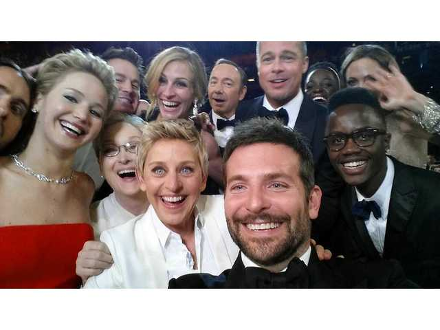 "This image released by Ellen DeGeneres shows actors as they pose for a ""selfie"" portrait on a cell phone during the Oscars at the Dolby Theatre on Sunday."