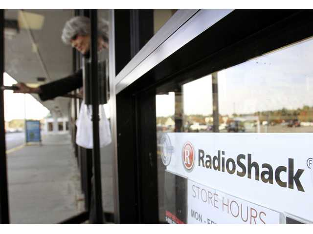 In this Oct. 20, 2010 photo, a shopper leaves a RadioShack store in Brunswick, Maine.