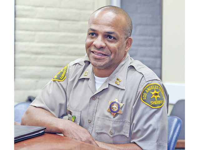 Newly appointed Santa Clarita Valley Sheriff's Station Capt. Roosevelt Johnson, the city's de facto chief of police, sits in a conference room at the station on Wednesday. Signal photo by Dan Watson.