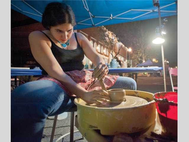 Andrea Weskamp gives a ceramics demonstration during Thursday night's ArtSlam. Signal photo by Charlie Kaijo.
