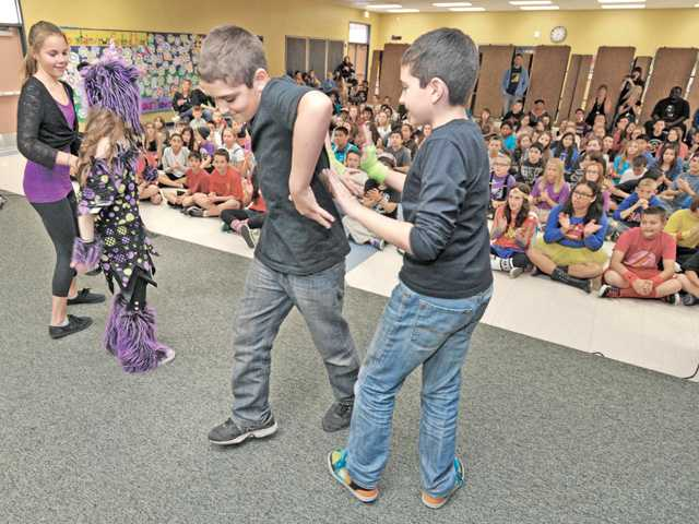The Creepstatic Monsters perform for fellow sixth-graders at Mountainview Elementary School in Saugus on Friday. Signal photo by Dan Watson