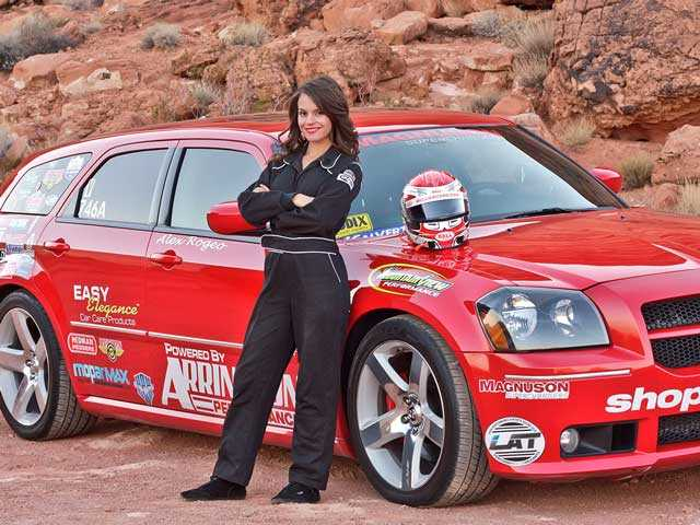 Alex Rogeo, female drag racer, posing with her race car.  Richard Kratz/courtesy photo