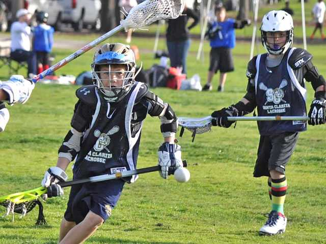 Two Wildcat players in the Lacrosse game at the Rose Bowl. Courtesy photo