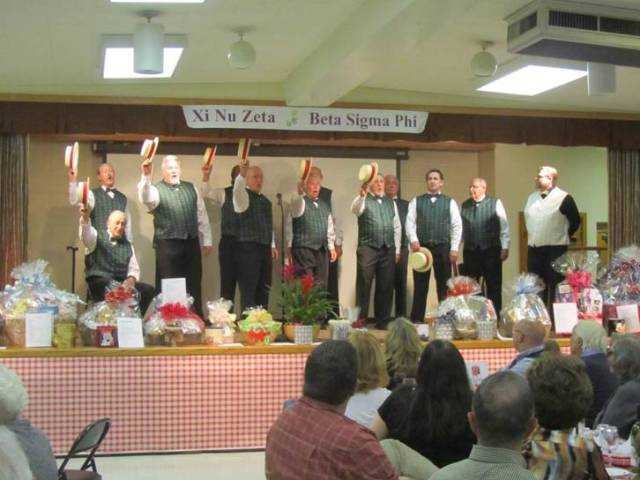 The Men of Harmony sign at the Xi Nu Zeta's Lasagna Dinner fundraiser. Barbara Duck/Courtesy photo