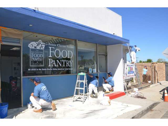 The nonprofit SCV Food Pantry gets a makeover during a free exterior painting.