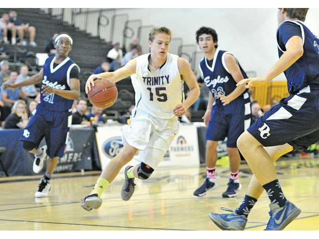 Trinity Classical Academy's Ryan Brooks (15) drives against Desert Chapel defenders on Saturday at Godinez High School.