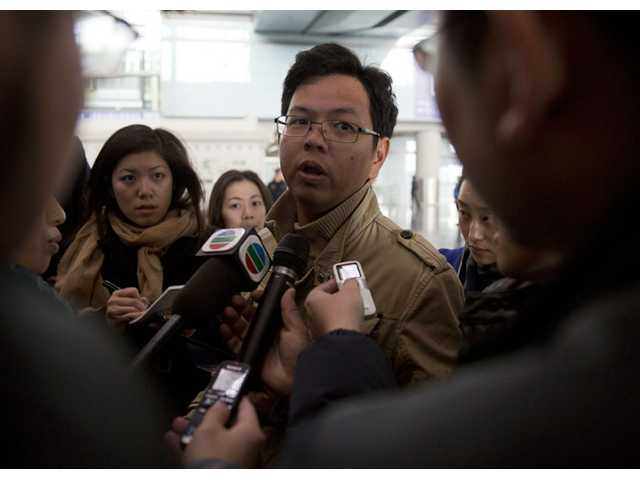 A Malaysian man who says he has relatives on board the missing Malaysian Airlines plane, talks to journalists at Beijing's International Airport Beijing, China on Saturday.
