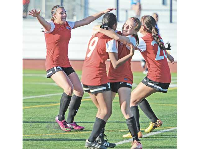Hart High's Destinney Duron, left, runs to meet her teammates after she scored the second goal for Hart against Chino Hills at Corona High School in Corona on Saturday in the CIF-Southern Section Division II title game.