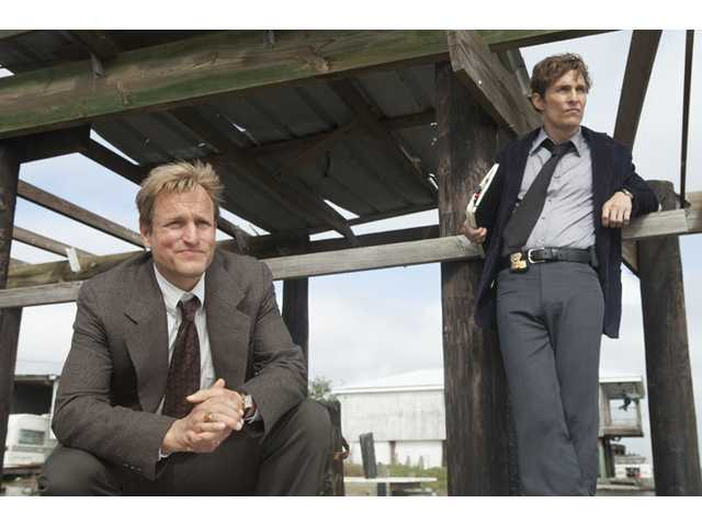 "This image released by HBO shows Woody Harrelson, left, and Matthew McConaughey from the HBO series ""True Detective."""