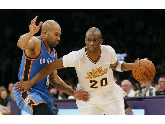 Los Angeles Lakers shooting guard Jodie Meeks, right, drives around Oklahoma City Thunder point guard Derek Fisher, left, on Sunday in Los Angeles.