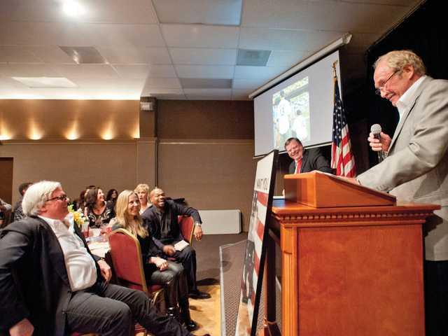 Don Fleming gets some laughs at the expense of city councilman Bob Kellar Satruday night.Signal photo by Charlie Kaijo.