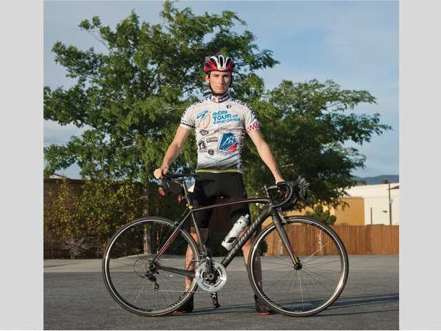 Aaron Hasson stands for a portrait with his bike at Terry Miller Park on Monday. Signal photo by Charlie Kaijo.