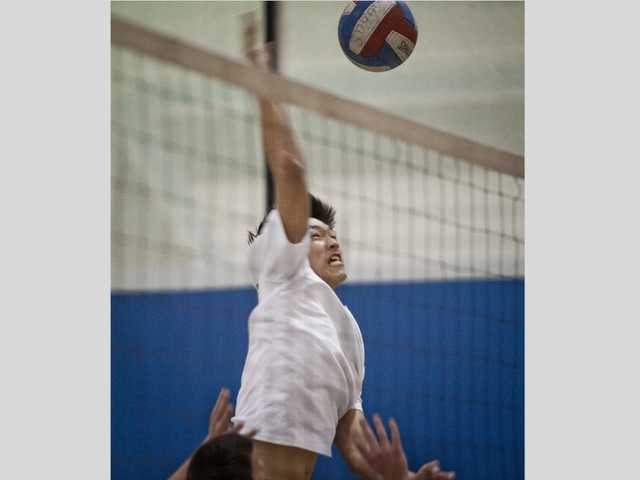 Saugus' Zach Choo spikes the ball on Thursday against Quartz Hill at Saugus High School.