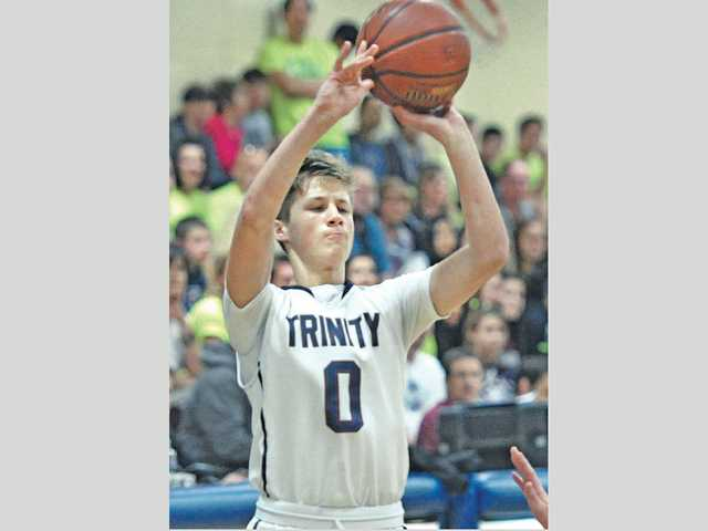 Trinity's Josh Mumper (0) shoots a 3-pointer on Wednesday at The Master's College in the Knights' win against Capistrano Valley.