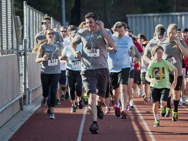 Runners take off at the starting line for the annual Michael Hoeffling Foundation Walk/Run for Children with Cancer. Signal photo by Charlie Kaijo