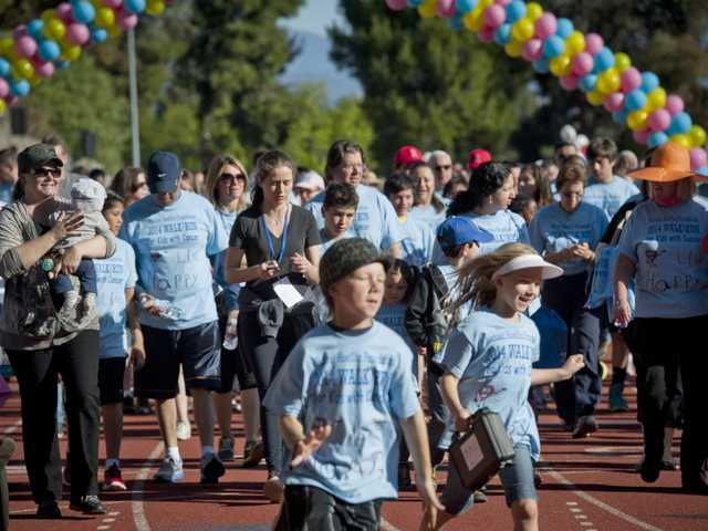 Walkers were welcome, along with runners, at the annual Michael Hoeffllin Foundation fundraising Walk/Run for Children with Cancer on Saturday at College of the Canyons. Signal photo by Charlie Kaijo