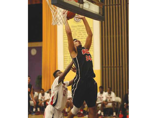 Santa Clarita Christian's Phillip Webb (34) rises to the rim against View Park on Saturday in Inglewood.